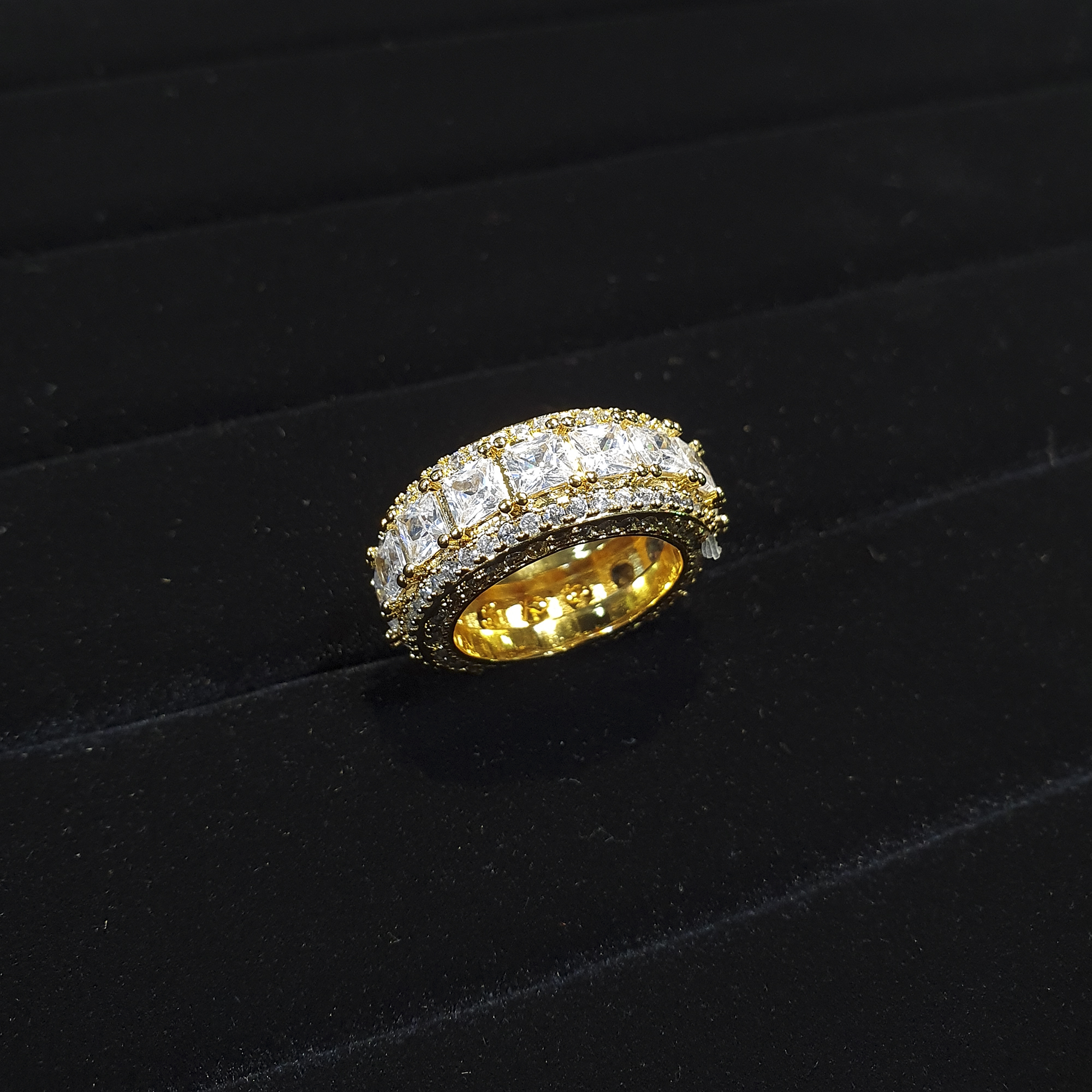 ICED OUT 3 ROW BAGUETTE SPINNER RING IN GOLD